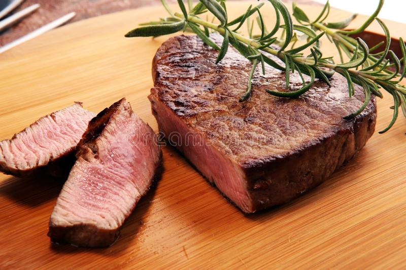 Barbecue filet Steak. Black Angus Prime meat steaks. Tenderloin fillet mignon royalty free stock images