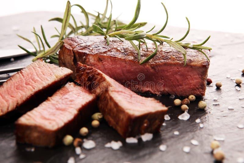 Barbecue filet Steak. Black Angus Prime meat steaks. Tenderloin fillet mignon royalty free stock images