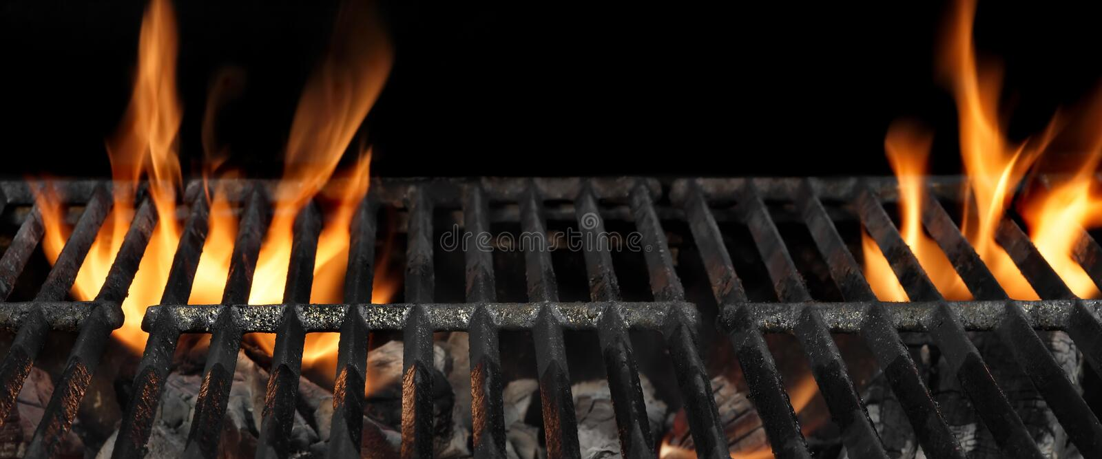 Barbecue Fire Grill Isolated On The Black Background, Close Up. Empty Barbecue Flaming Charcoal Grill With Bright Flames Of Fire Isolated On The Black Background royalty free stock photography