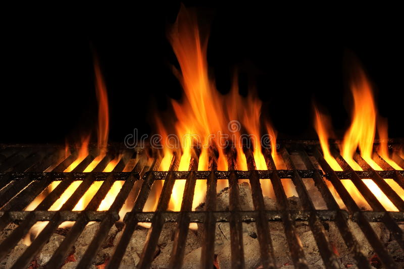 Barbecue Fire Grill Isolated On The Black Background, Close-up. Empty Barbecue Flaming Charcoal Grill With Bright Flames Of Fire Isolated On The Black Background royalty free stock image