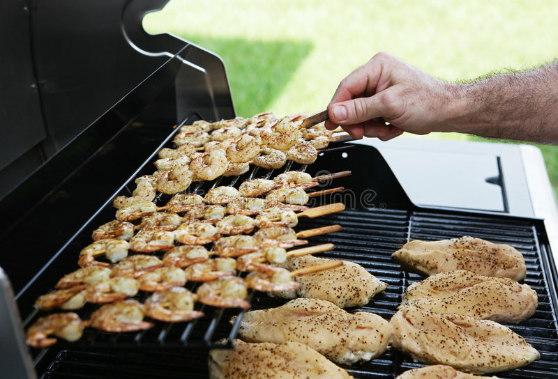 Barbecue Flipping Shrimp royalty free stock photography