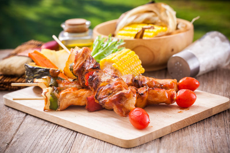 Barbecue in garden. At summer royalty free stock photo