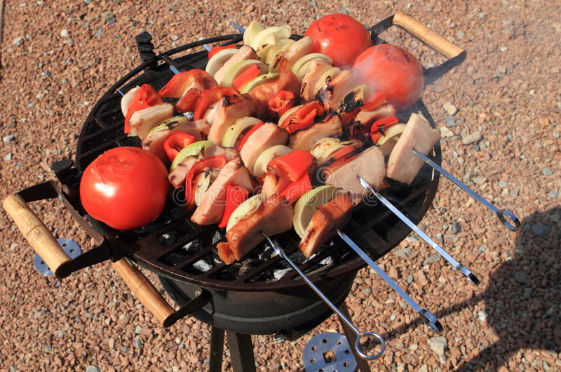 Barbecue grill. With mixed ingredients stock photos