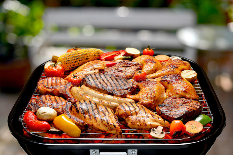 Barbecue on the grill. Assortment of barbecue on the grill on outdoor background royalty free stock image
