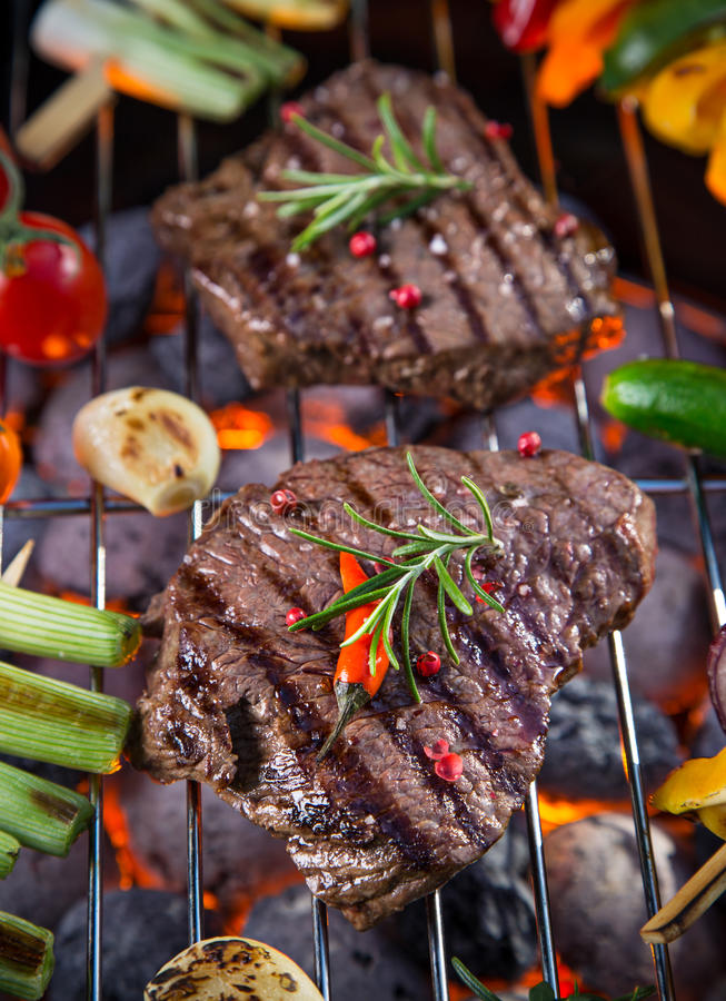 Barbecue grill with beef steaks, close-up. Barbecue garden grill with beef steaks, close-up royalty free stock images