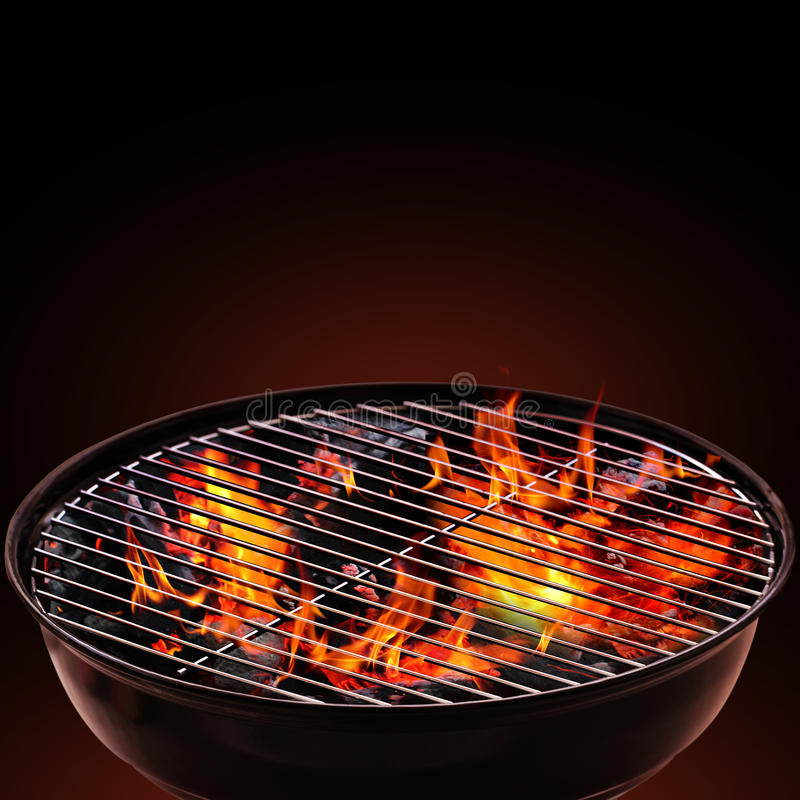 Barbecue Grill on Black Background. Barbecue blazing ember on a black background stock images