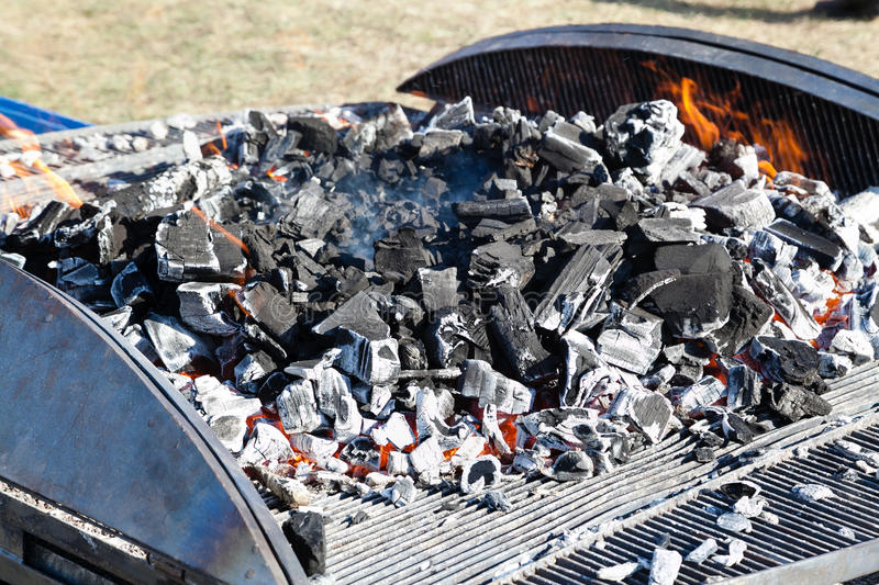 Barbecue grill with burning charcoal royalty free stock photos