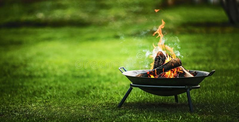 Barbecue Grill with Fire. On nature stock photos
