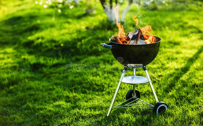 Barbecue Grill with Fire. On Nature royalty free stock photography