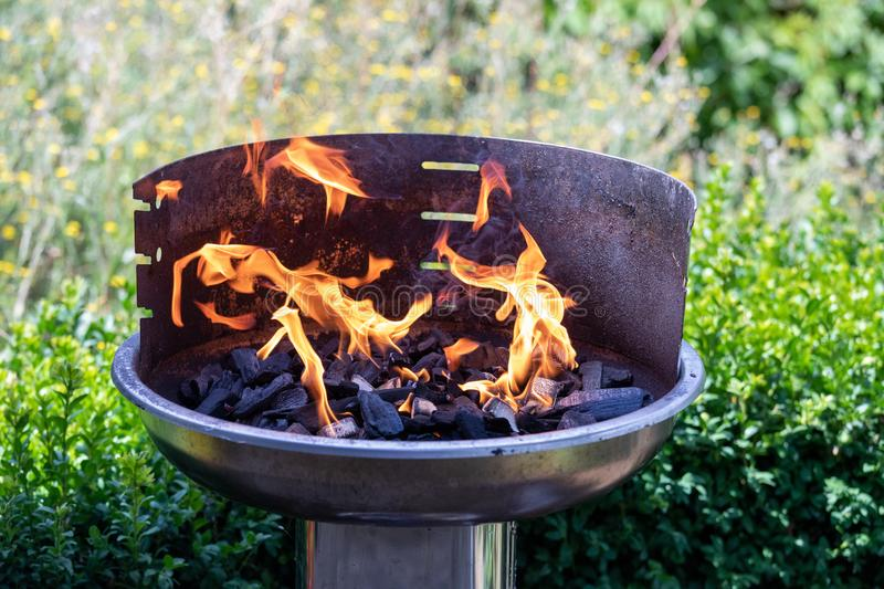 Barbecue grill with fire on nature, outdoor, close up.  stock photography
