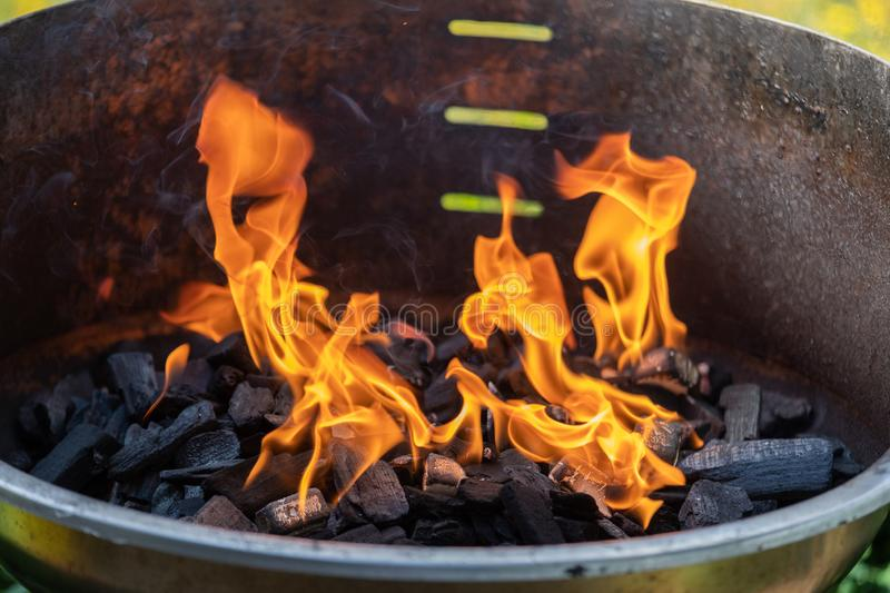 Barbecue grill with fire on nature, outdoor, close up.  royalty free stock images