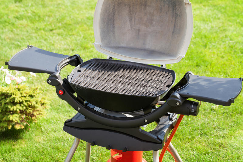 Barbecue grill. At outdoor garden stock photography