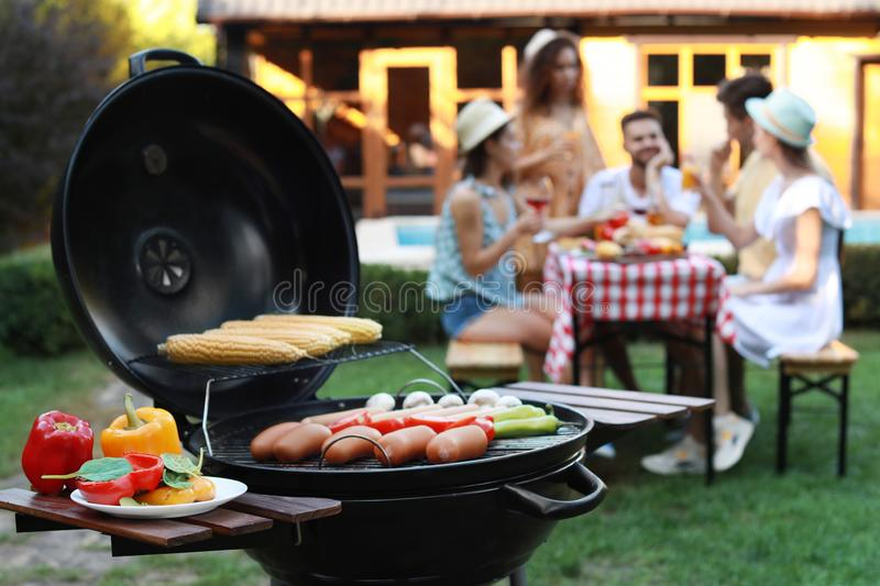 Barbecue grill with sausages and vegetables stock images