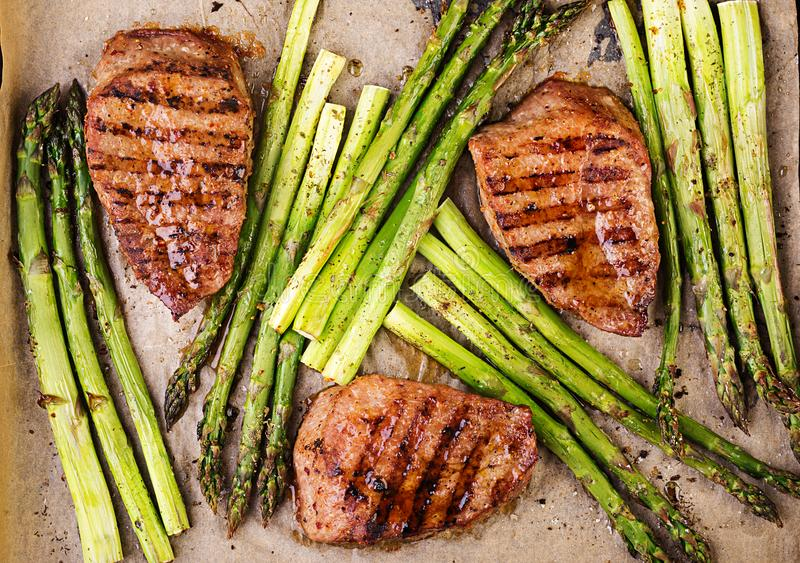 Barbecue grilled beef steak meat with asparagus and herbs. royalty free stock image