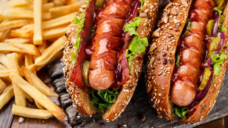 Barbecue grilled hot dog. With french fries royalty free stock photo