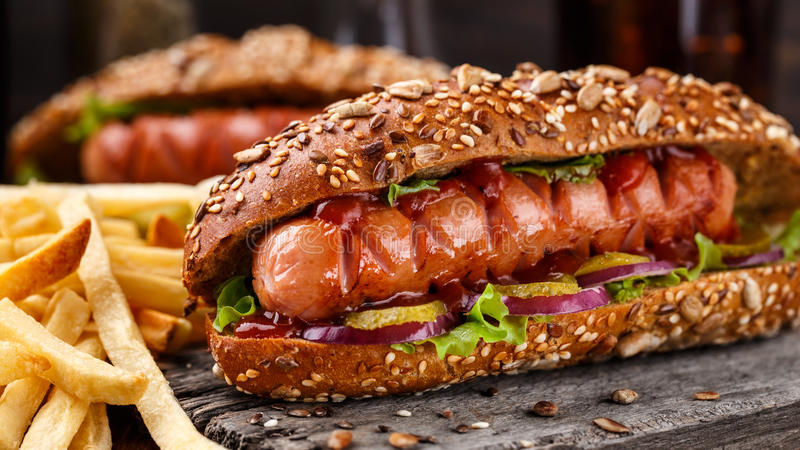 Barbecue grilled hot dog. With french fries stock photos