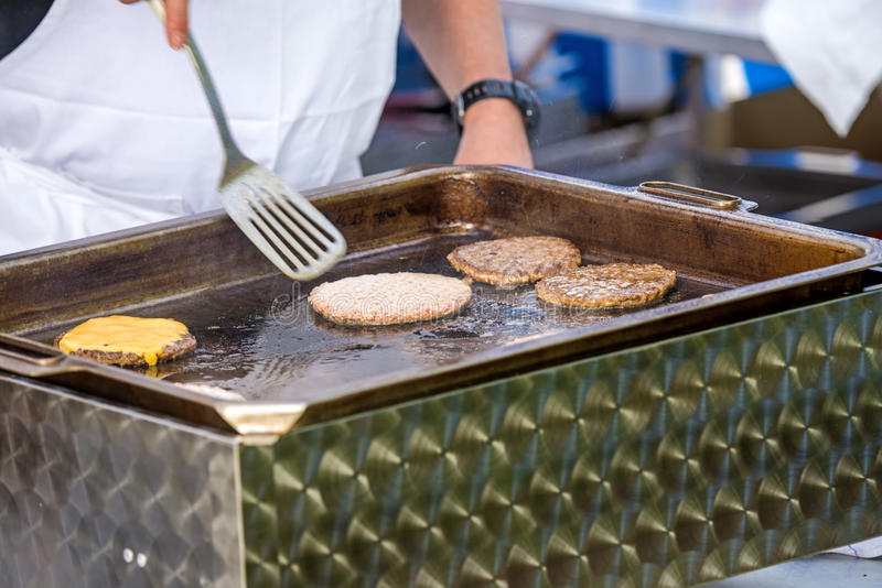 Barbecue with hamburger stock photo