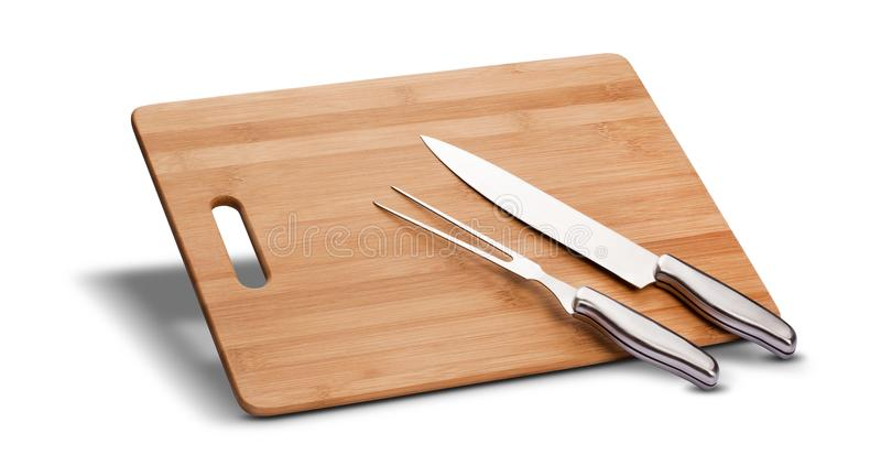 Barbecue kit with wood to cut meat, knife and long fork, isolated in white background.  stock image