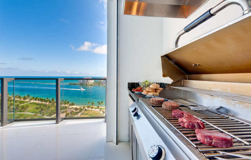 Barbecue in luxury terrace. View of a barbecue in an luxury terrace with ocean view stock images