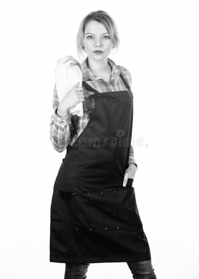 Barbecue master. Woman checkered shirt and apron for cooking white background. Grilling food. Cooking meat at low royalty free stock photography