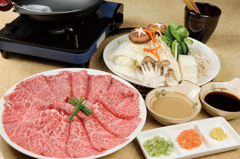 Barbecue meat. Rich Japanese barbecue restaurant on table royalty free stock images
