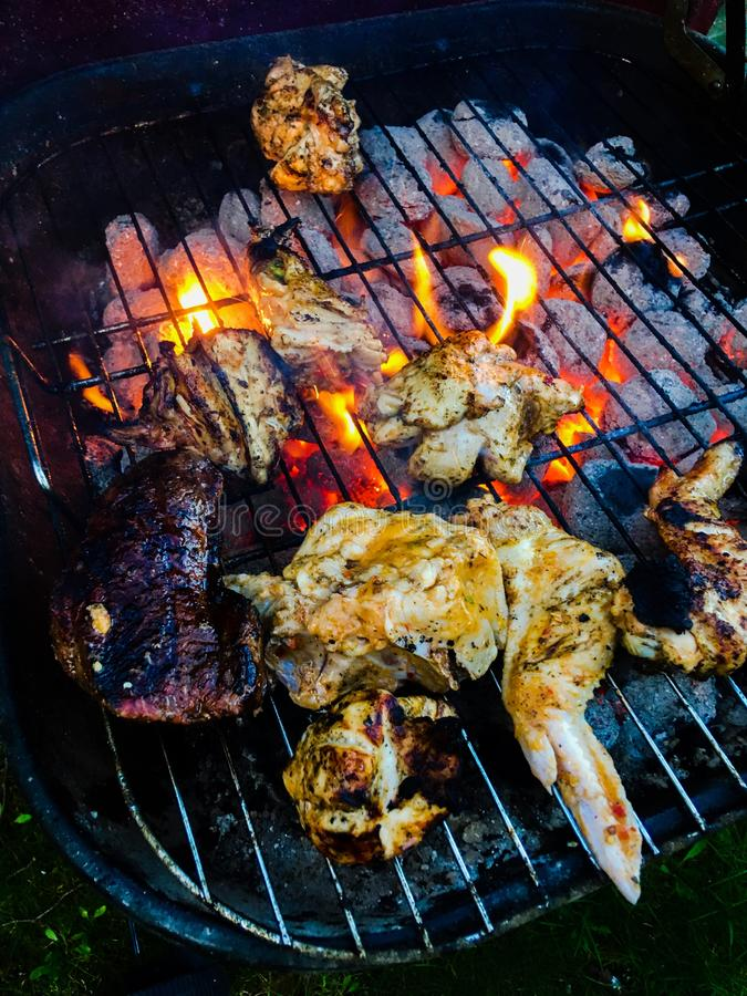 Barbecue meat cooking. Cooked tasty braai royalty free stock photography