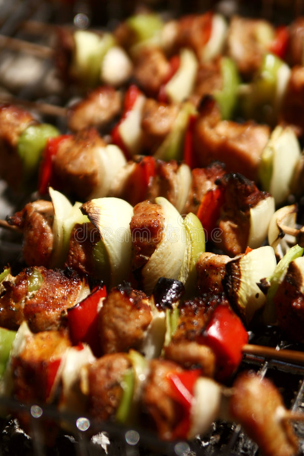 Barbecue with meat skewers. Barbecue with delicious grilled meat on grill royalty free stock photo