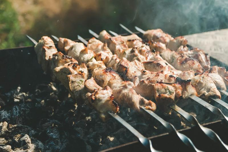 Barbecue meat on skewers on grill, steak stock photo