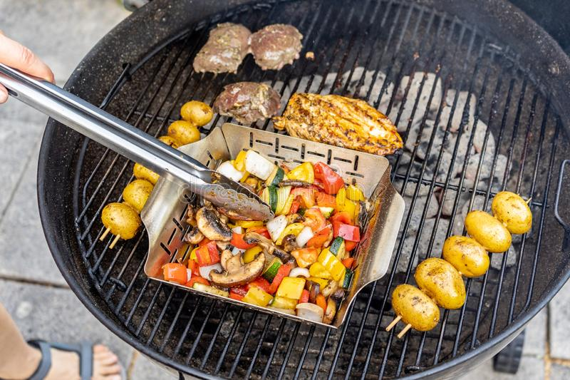 Barbecue with meat and vegetables on a terrace. stock photo