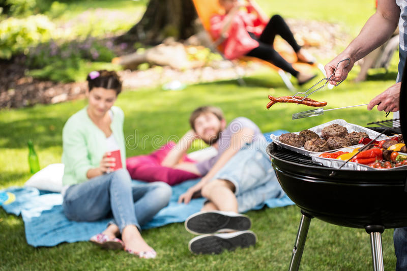 Barbecue in park with friends stock image