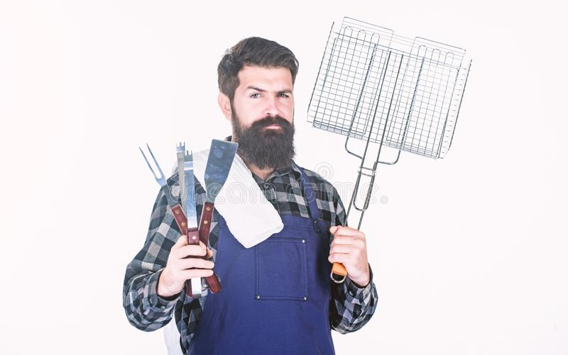 Barbecue party. Grill cook using portable barbecue cooking tools. Happy hipster holding stainless steel tools for. Preparing barbecue food. Bearded man with stock photo