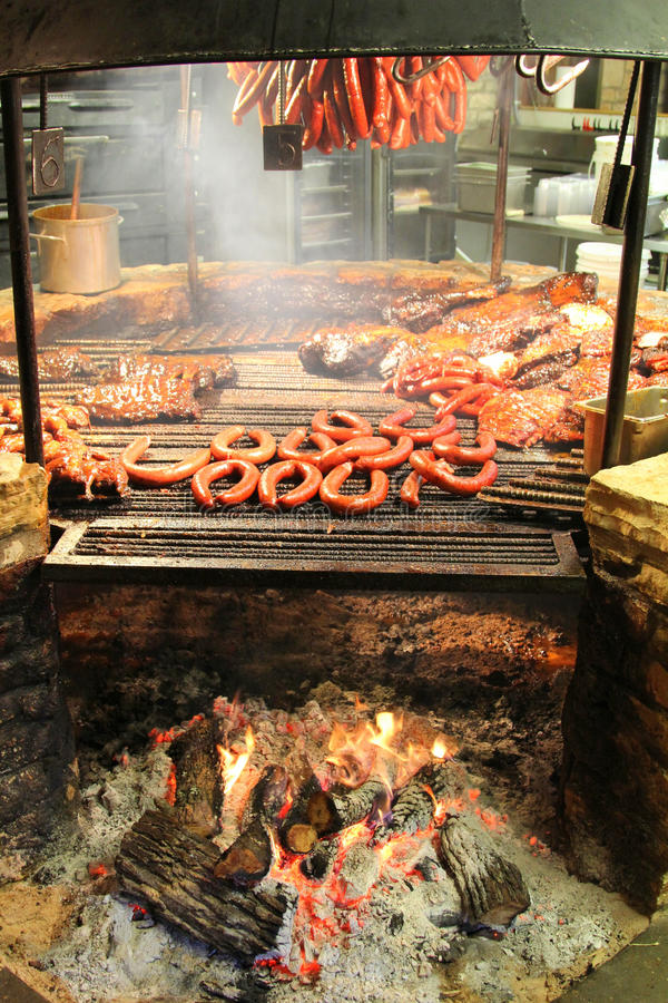 Barbecue pit. A barbecue pit full of meet stock photos