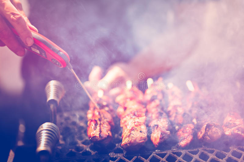 Barbecue. Pork on skewers cooked on barbecue grill stock images