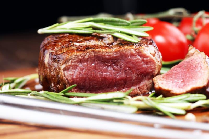 Barbecue Rib Eye Steak - Dry Aged Wagyu Entrecote Steak. Barbecue Rib Eye Steak. Black Angus Prime meat steaks Machete, Striploin, Rib eye, Tenderloin fillet royalty free stock photo