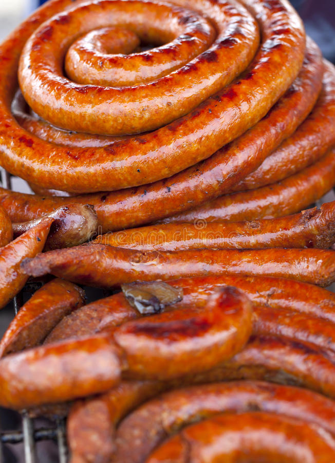 Barbecue Sausage on a Grill. Close-up of barbecue sausage on a grill. Selective focus on the top of the picture stock images