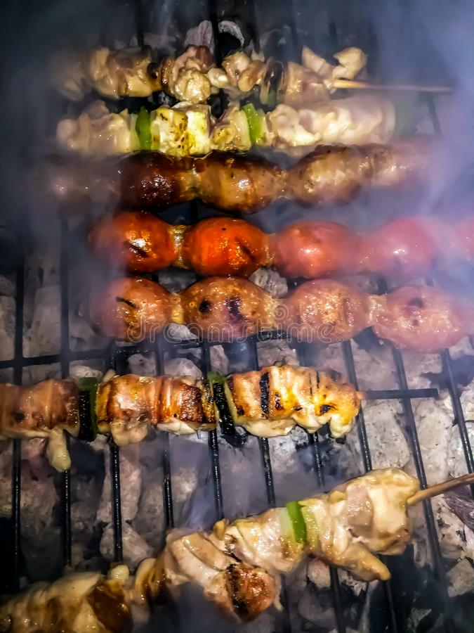 Barbecue with sausage and skewers stock image