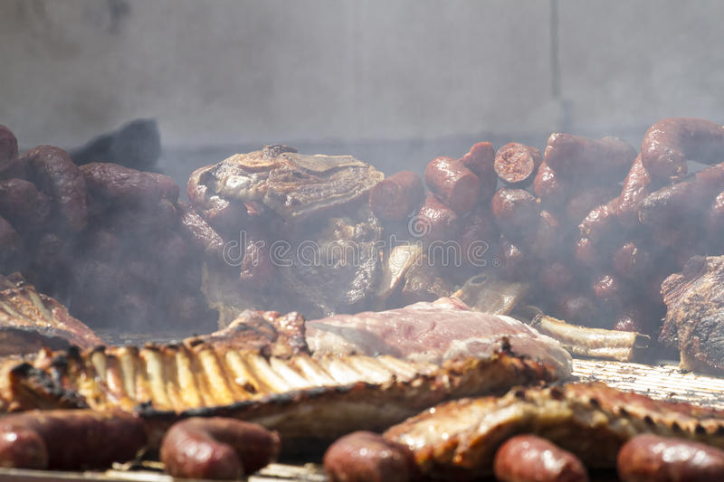 Barbecue with sausages and pork sausages royalty free stock photos