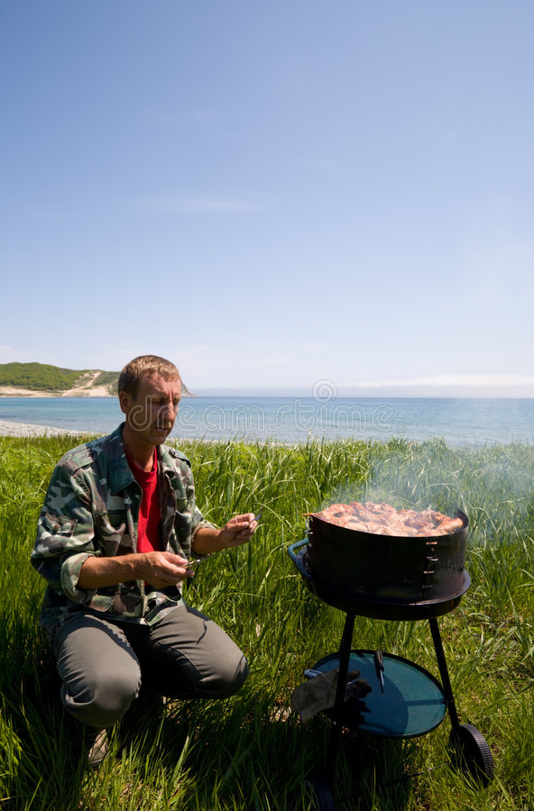 Barbecue & sea royalty free stock images