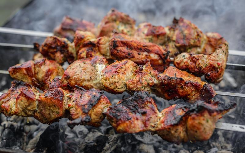 Barbecue or shish kebab is fried on the grill. royalty free stock photography