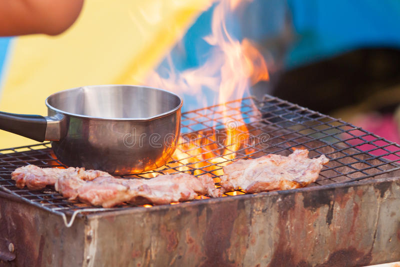 Barbecue in a simple way in wild, collect stones as grill royalty free stock photography