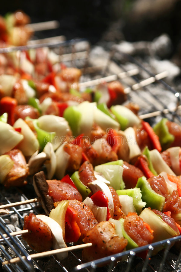 Barbecue with skewer. Barbecue with delicious grilled meat on grill stock photos