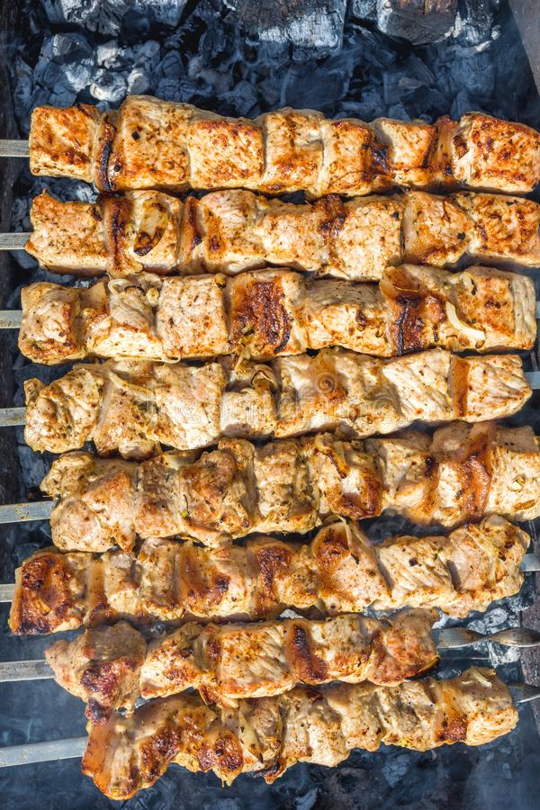 Barbecue. Skewers on skewers in the grill, barbecue, bbq, meat, steak, food, beef, grilled, cooking, grilling, summer, fire, meal, background, barbeque, charcoal stock image