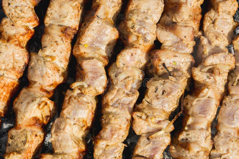 Barbecue. Skewers on skewers in the grill, barbecue, bbq, meat, steak, food, beef, grilled, cooking, grilling, summer, fire, meal, background, barbeque, charcoal royalty free stock photos