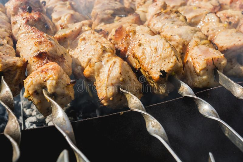 Barbecue. Skewers on skewers in the grill, barbecue, bbq, meat, steak, food, beef, grilled, cooking, grilling, summer, fire, meal, background, barbeque, charcoal royalty free stock image