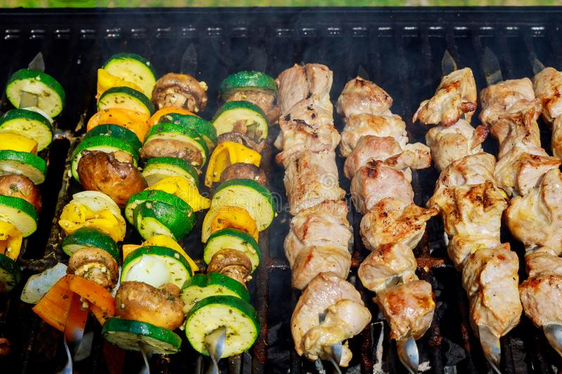 Barbecue smoking on the grill meat and vegetables stock photography