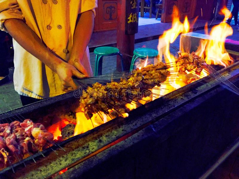 Delicious street food of Barbecued Lamb shish kebabs in china. Chinese delicious street food of Barbecued Lamb shish kebabs on the streets of lanzhou gansu china royalty free stock photography