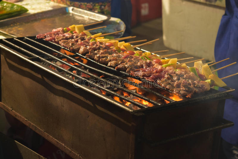 Grilling shashlik on barbecue grill. Selective focus.  stock images