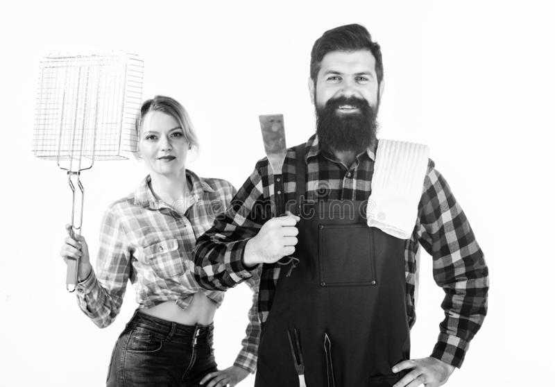 Barbecuing common technique. Essential barbecue dishes. Bearded hipster and girl hold cooking grilling utensils white royalty free stock photos