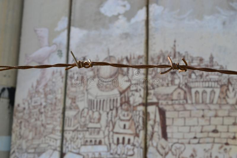 Barbed fence, old city of Jerusalem, Art and writings on the wall in Bethlehem, between Palestine Westbank and Israel. Art on the wall in Bethlehem, between royalty free stock photography