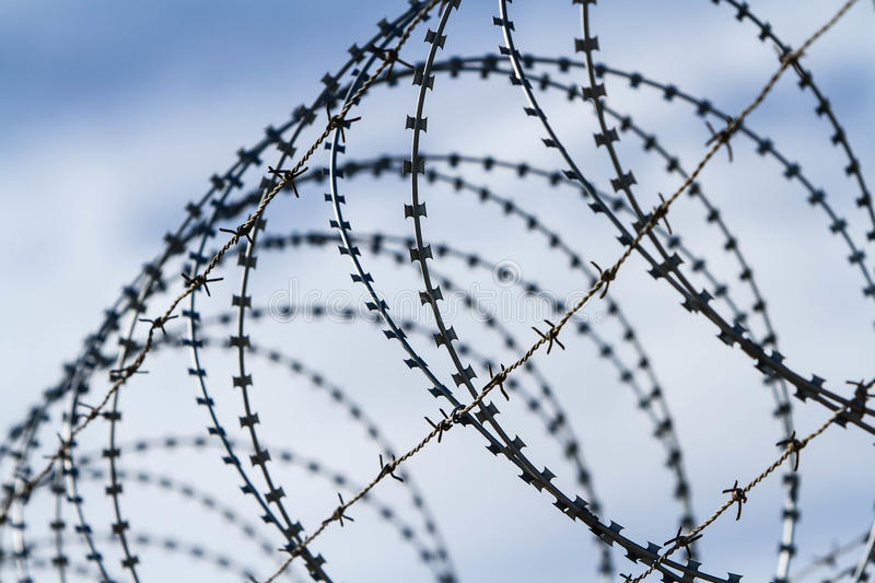 Barbed And Razor Wire Fence Stock Photography